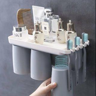 Toothbrush and magnetic cup holder