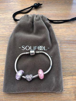 Silver bracelet with pink charms