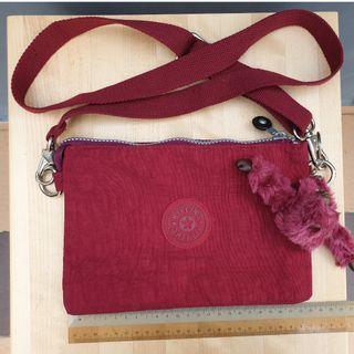 Kipling red sling bag