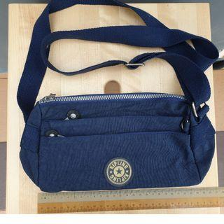 Kipling blue sling bag
