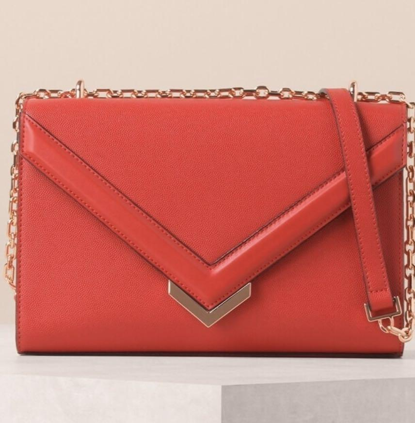 Red handbag with chain strap