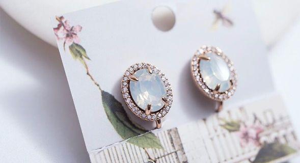 GRACEFUL OVAL CRYSTAL WITH CUBIC ZIRCONIA EAR-CLIP EARRINGS