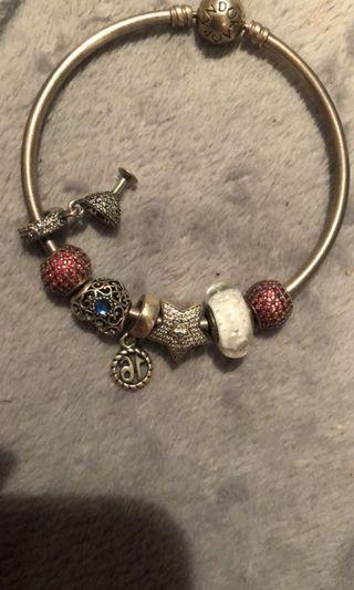 Pandora bangle and charms