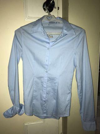 Light blue long sleeved polo