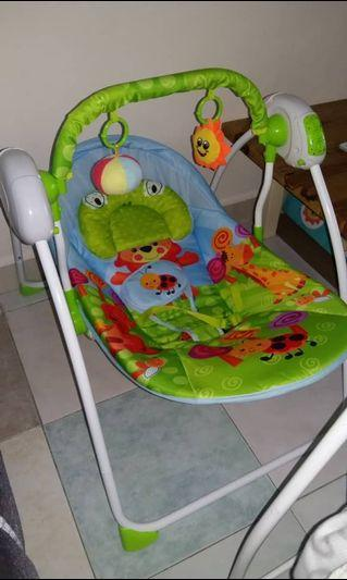 Remote controlled baby swing with mosquito net