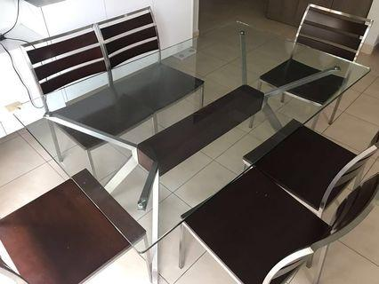 Glass dining table with solid wood