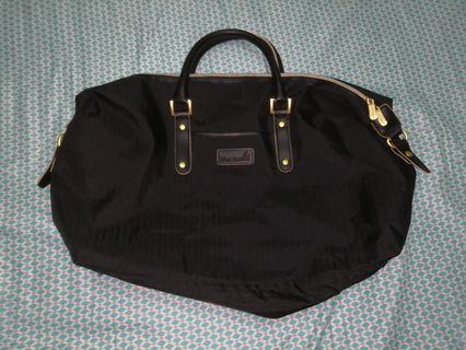 Remy Martin luggage bag