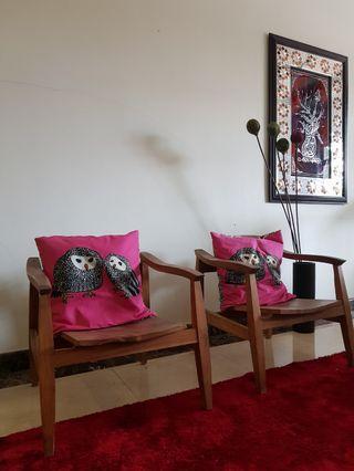 A pair of contemporary teak chair