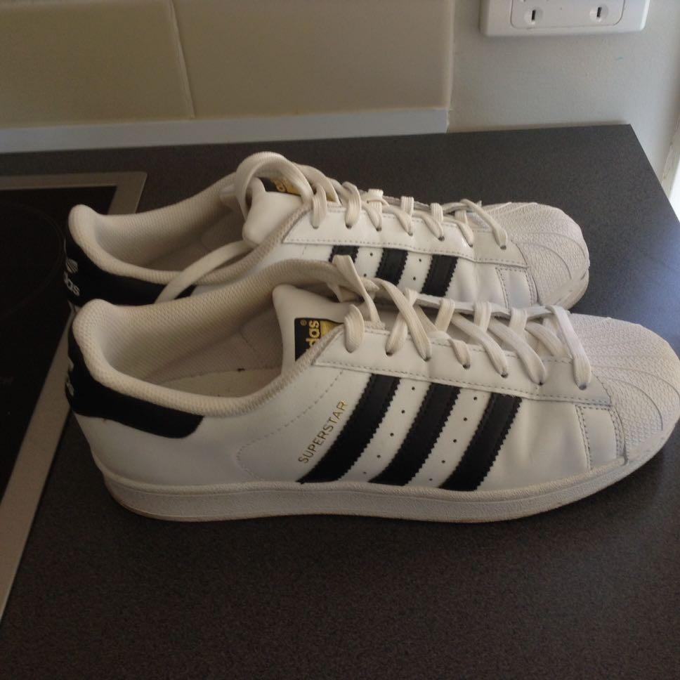 Adidas men sneakers  size 9 us or 42and half men size