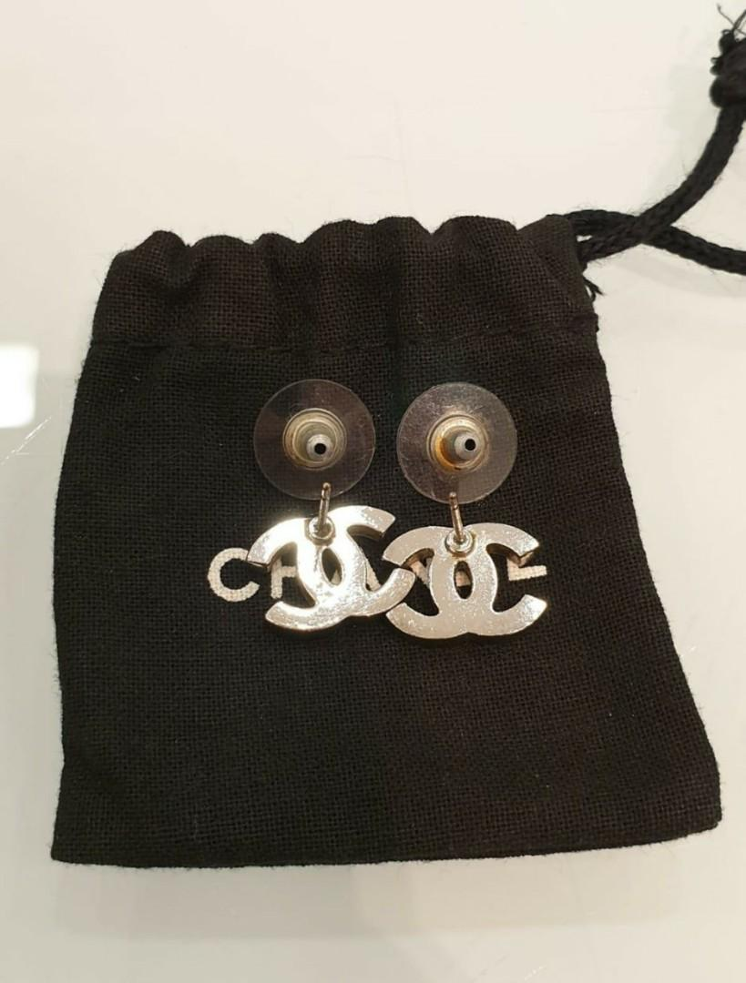 100% AUTHENTIC!! PRE-LOVED CHANEL EARRINGS! WORE ONLY A FEW TIMES! UNDER USE! DOESNT COME WITH RECEIPT! EAR STUD BACKING ALITTLE RUSTY DUE TO KEEPING INSIDE THE BOX FOR AWHILE, YOU CAN CHANGE BACKING ON YOUR OWN. NOT FOR FUSSIES,  ALCOHOL CLEAN!!