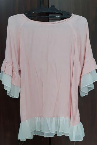 frilled soft pink top
