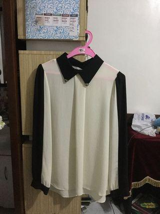 Black and white long sleeves with accentuated collar