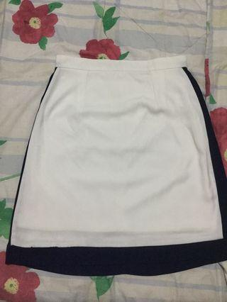 White skirt with navy blue accent