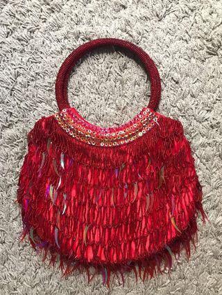 Red sequins handbag