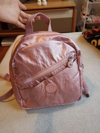 🚚 Kipling small metallic rose backpack