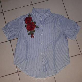 Rose embroidered polo shirt