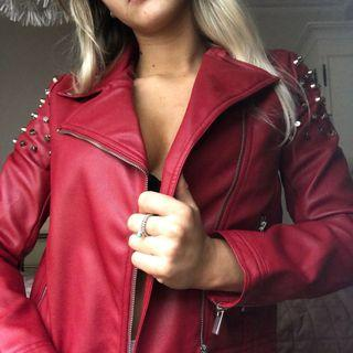 Red faux leather biker jacket size 8 with studded detailing