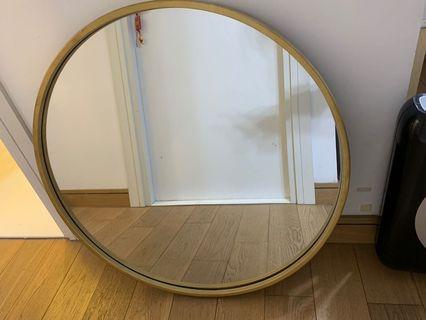 Gold rimmed round mirror