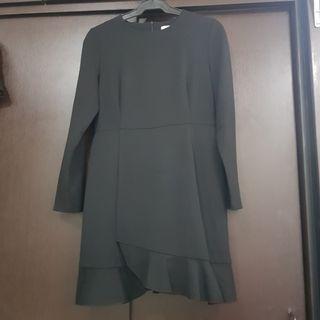 Long Sleeved Black Dress with Ruffled Hem
