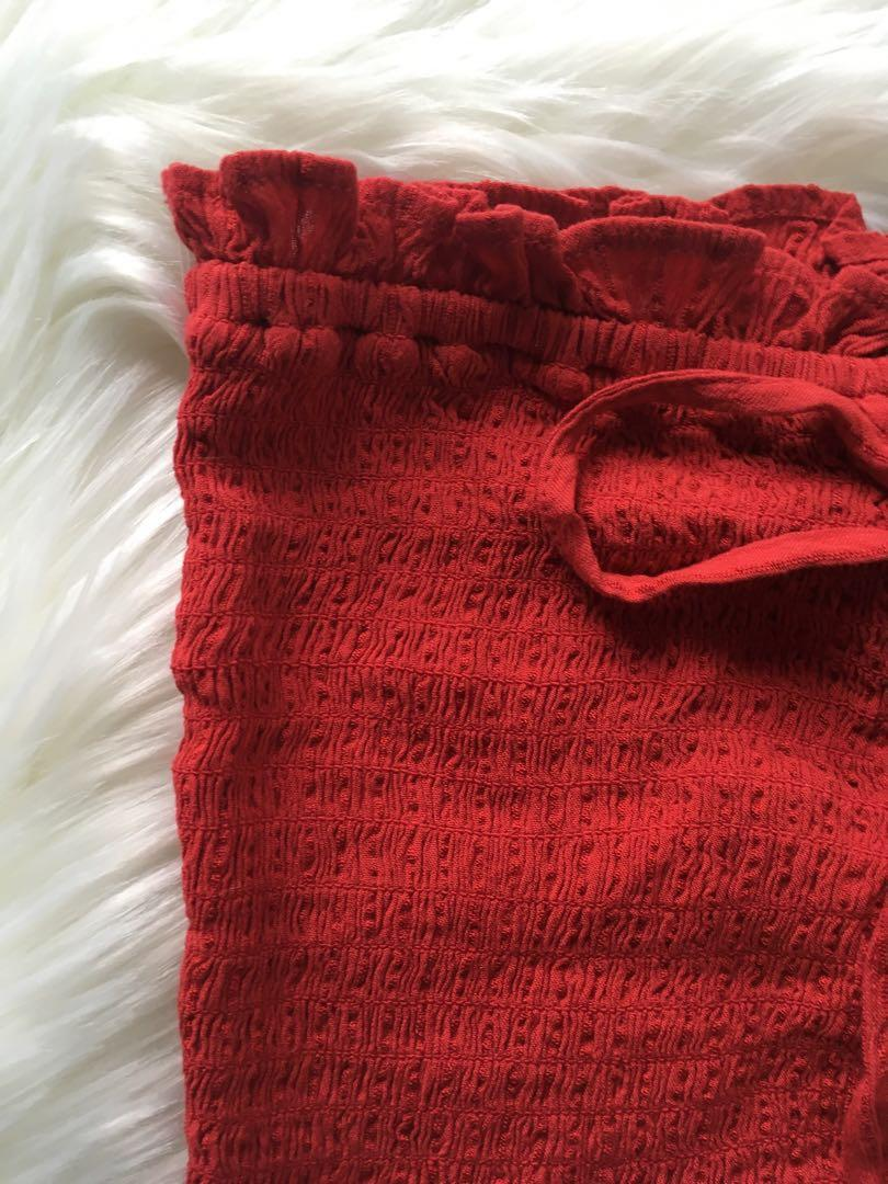American Eagle red lace up tube top with small ruffles or frills size small