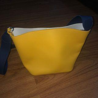 Yellow white sling bag