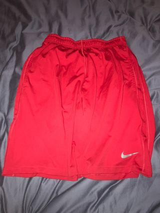Red Nike active shorts