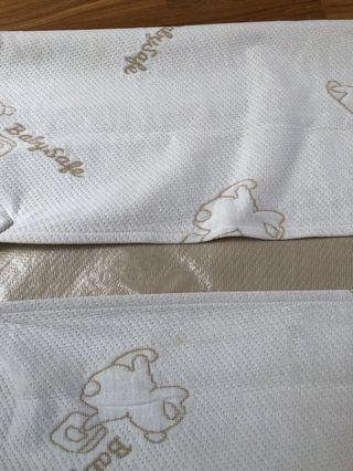 Baby safe crib mattress protector - slight stains