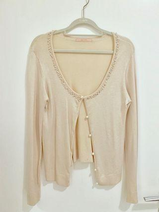 Pink cardigan with pearl details