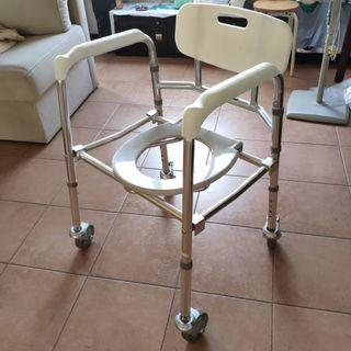 Lifeline commode chair with lockable wheels.