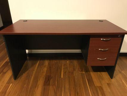 Large desk with locking drawers.