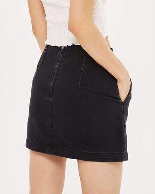 Size 4 Topshop Moto black denim A-line mini skirt with pockets