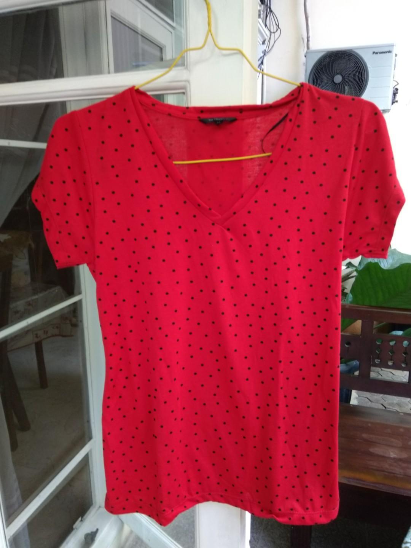 The executives red polkadot shirt