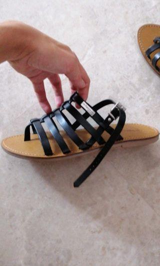 🚚 Tropeziennes black sandals