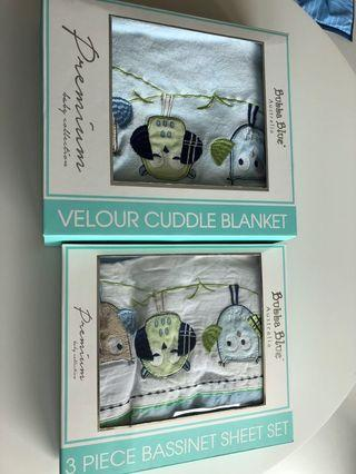Bassinet sheet set and blanket