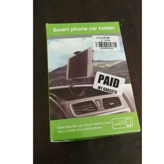 [New and never used] Car dashboard phone holder - Garage sale everything must GO!