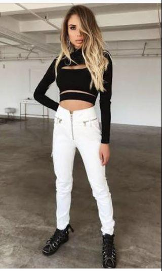 White pants with zips