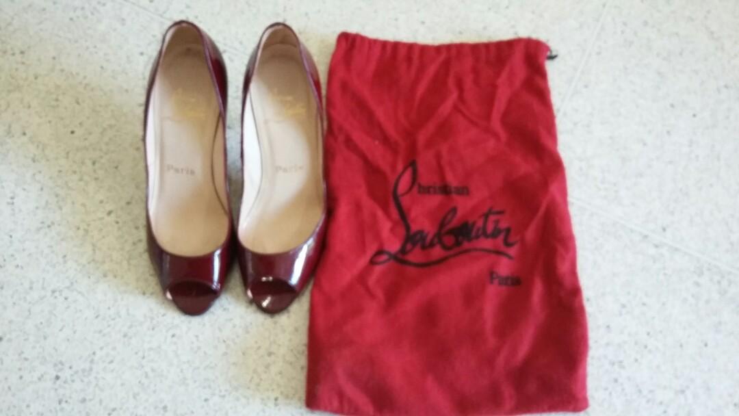 huge selection of d6451 6c52a Christian Louboutin red peep toe women's heels