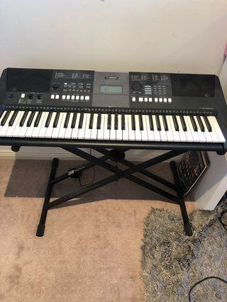 Yamaha keyboard and adjustable stand