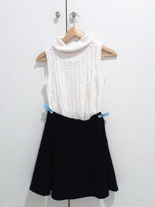 White top , black skirt
