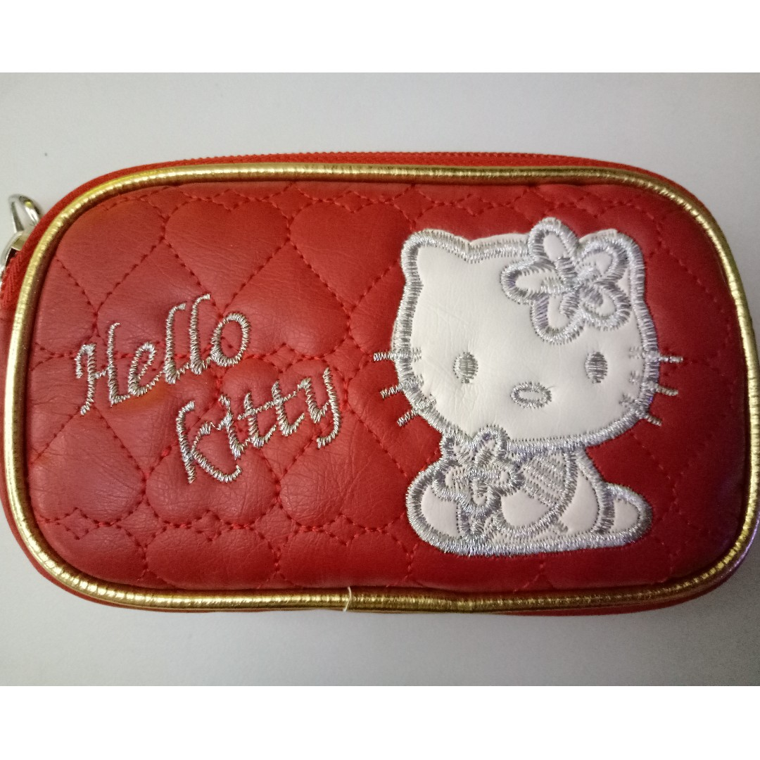 74a3f34e8 Left with 4 Hello Kitty wallet, coin purse, pouch, wristlet with 2  compartments, Women's Fashion, Bags & Wallets, Wallets on Carousell