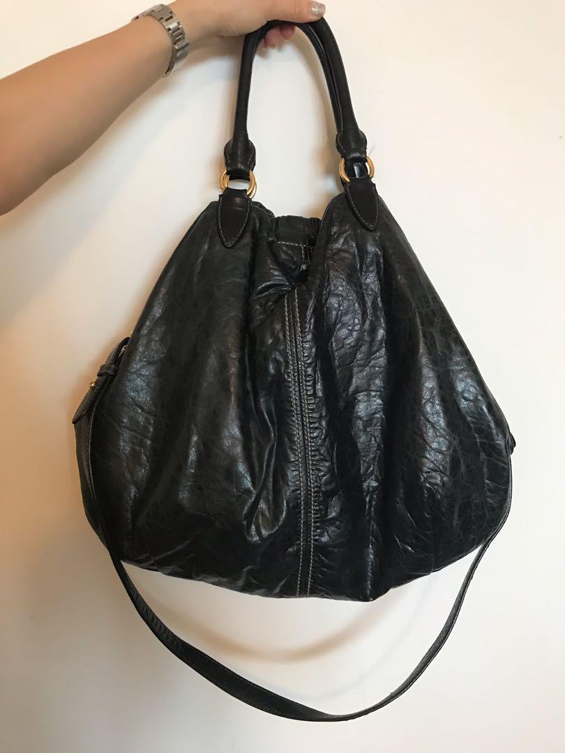 5754b8df9 Miu miu distressed leather hobo bag (large), Women's Fashion, Bags &  Wallets, Handbags on Carousell