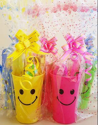 Children birthday goodie bag, goody bag, smiley cup, dragonfly led toy, colouring egg, flute
