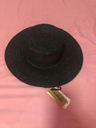 Cotton on straw hat