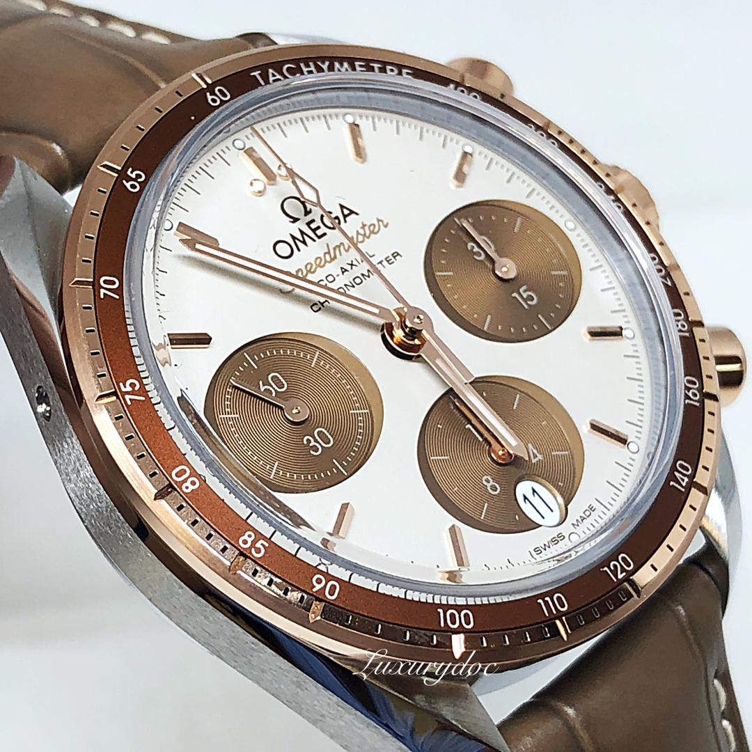 FS.BNIB OMEGA SPEEDMASTER 38 CAPPUCCINO STEEL ON SEDNA GOLD CO-AXIAL AUTOMATIC 38MM WATCH 324.23.38.50.02.002