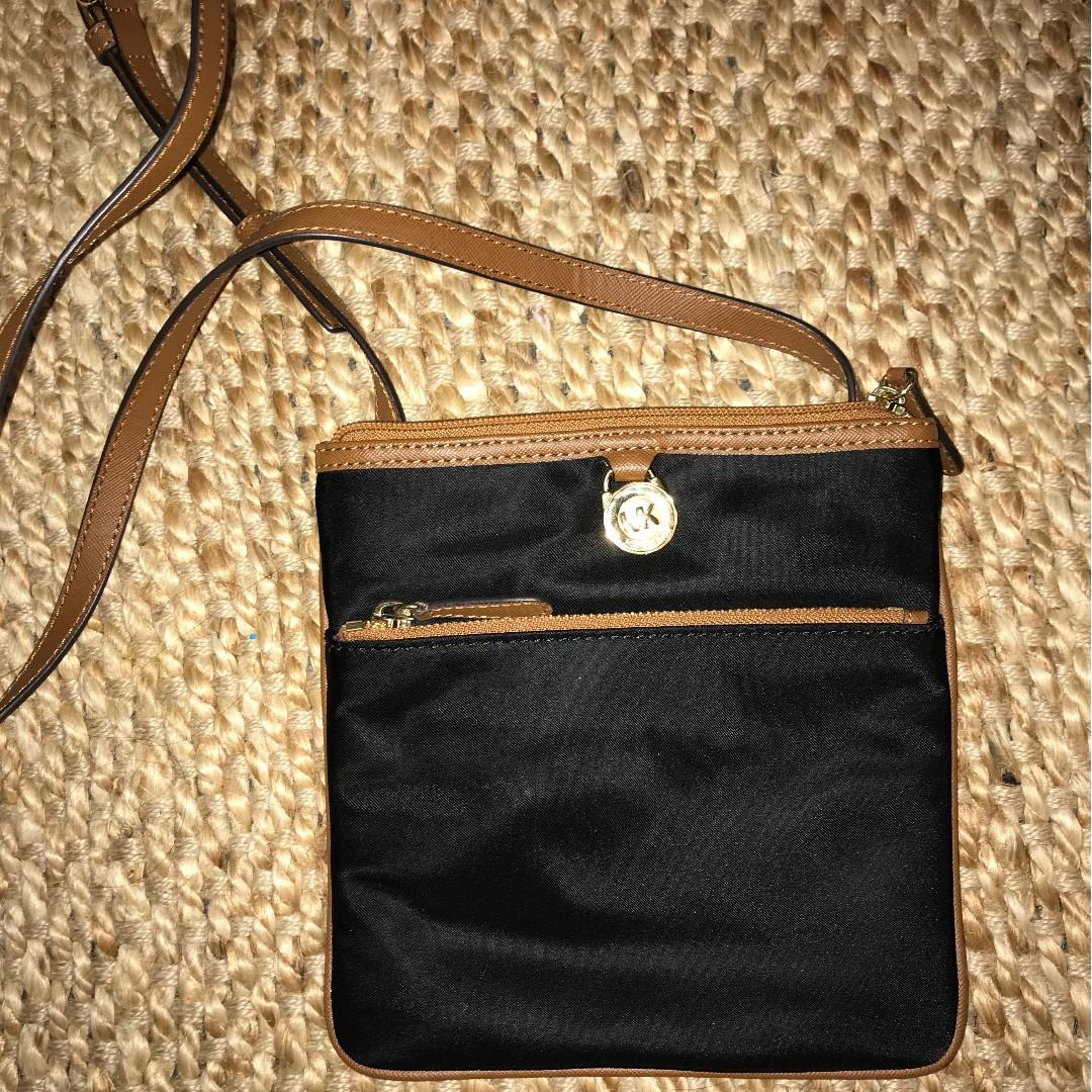 Perfect Condition Micheal Kors Cross body bag (Black with brown leather trim and violet interior)