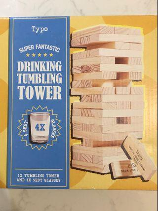 Drinking tumbling jenga tower with shot glasses