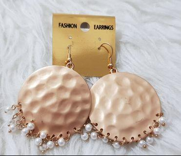 Gold earrings from India