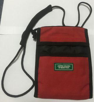 United Colours of Benetton pouch with strap.