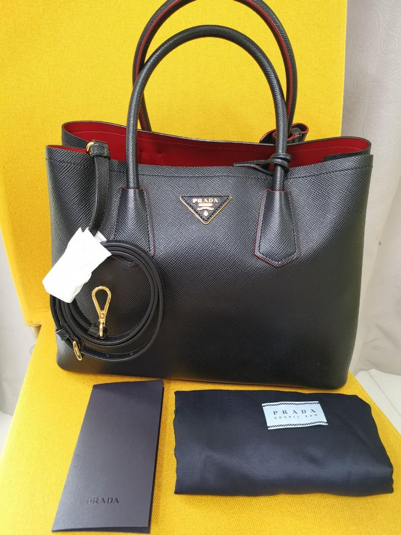 Prada Bag BN2775. 100% Authentic and 100% NEW. Lightweight design with full Saffiano Leather. Nero (Black with red on inner side)