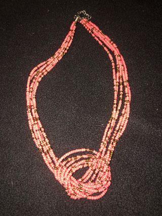 Aldo coral knot statement necklace